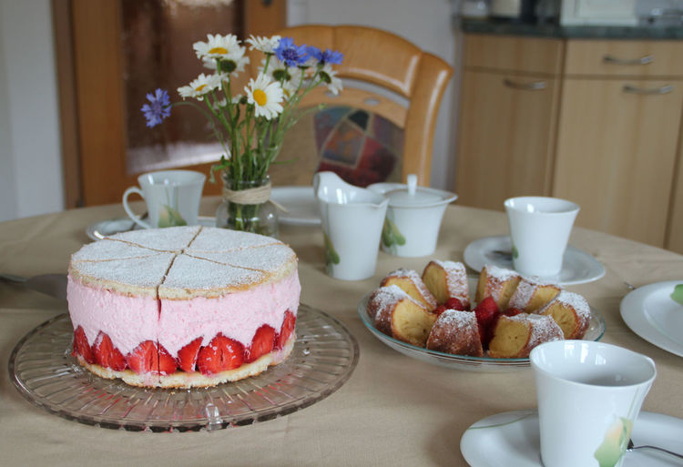 Cake served on table at home