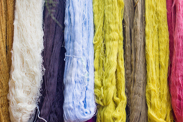 Full frame shot of multi colored threads for sale at market stall
