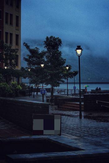 Illuminated street light against sky at dusk