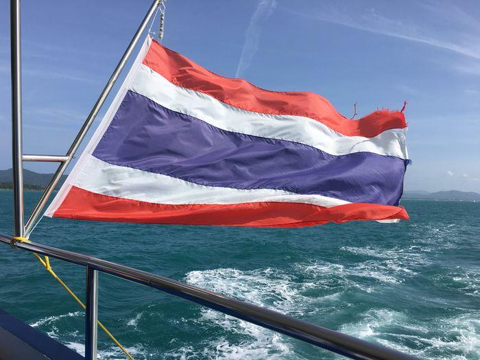 Thai flag on boat against sky