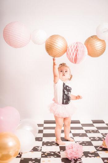 Full length of a girl holding balloons
