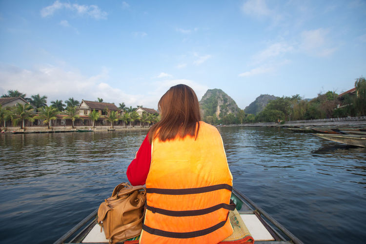 Tam Coc, Vietnam Water Rear View Nautical Vessel Real People One Person Lifestyles Sky Transportation Nature Leisure Activity Mode Of Transportation Beauty In Nature Sitting Day Hairstyle River Cloud - Sky Waist Up Women Outdoors Tam Coc Vietnam Travel