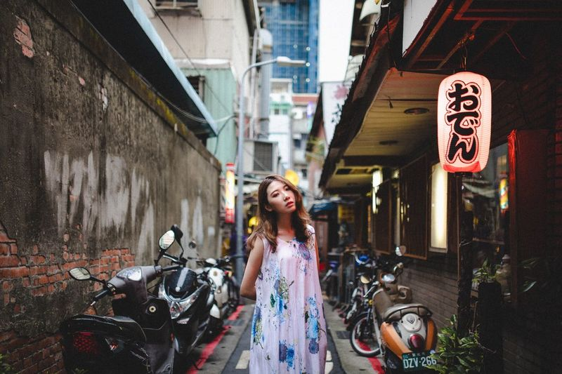 Architecture One Person Building Exterior City Young Adult Front View Leisure Activity Built Structure Real People Graffiti Standing Adult Young Women Casual Clothing Street Women Long Hair Lifestyles Emotion Hairstyle