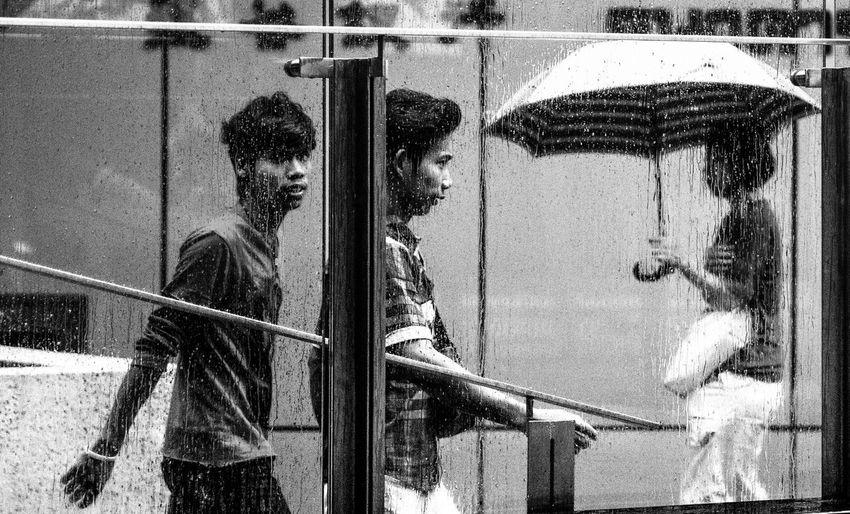 Caught in the rain. First Eyeem Photo rain Kuala Lumpur black and white wet street photography streetmalaysia black and white photography