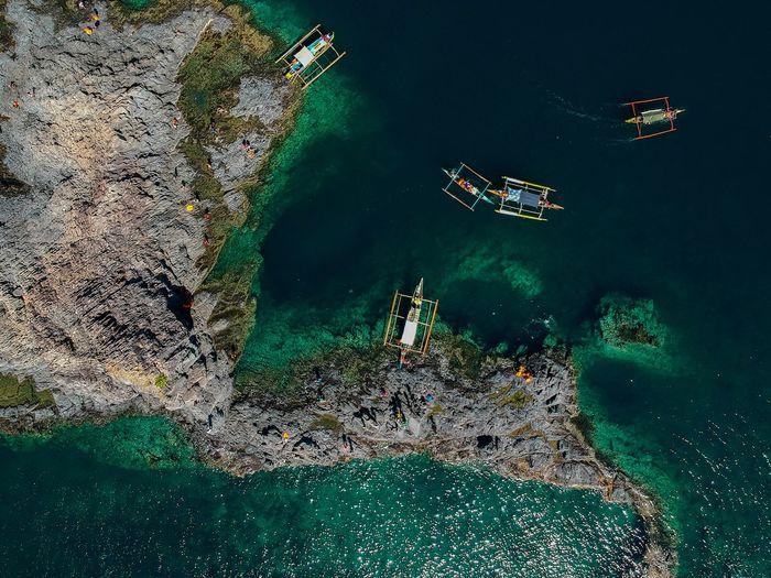 Aerial View Of Ships Moored At Sea