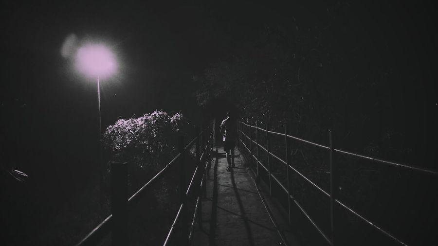 i walk a lonely road the only one that I've ever known... Night Lights Smartphonephotography Awesome_shots Awesome Nightphotography Real People Noir Et Blanc Noir EyeEm Best Shots First Eyeem Photo Awesome_nature_shots Night The Way Forward Illuminated Outdoors No People Sky
