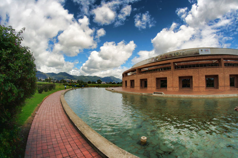 Architecture Beauty In Nature Biblioteca Virgilio BBarco Bogota,colombia. Built Structure Canal Cloud Cloud - Sky Cloudy Day Diminishing Perspective Grass Nature No People Outdoors Rippled Scenics Sky The Way Forward Tranquil Scene Tranquility Travel Destinations Water