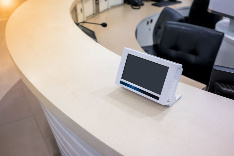 Digital Tablet At Reception Counter In Office