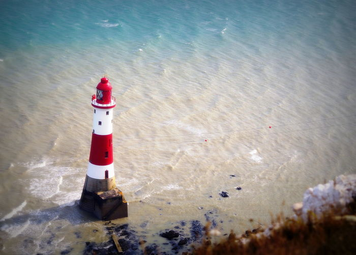Cliff EyeEmNewHere Lighthouse Nature Protection Red White Red White Blue Safety Sea Water