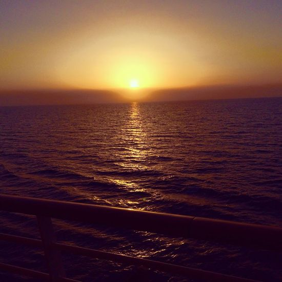 Sunset Sea Scenics Beauty In Nature Nature Water Tranquil Scene Sun Tranquility Horizon Over Water Idyllic Orange Color Sky Sunlight No People Outdoors Vacations Travel Destinations Wave