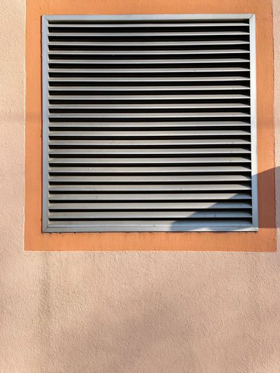 Closed shutter window of building