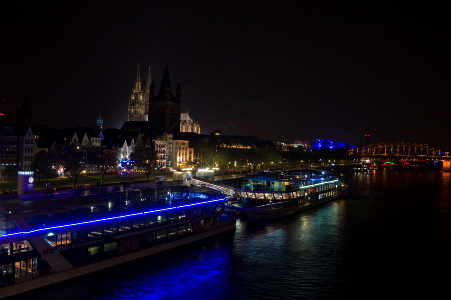 After midnight view at Cologne Köln Rhine Architecture Bridge Bridge - Man Made Structure Building Building Exterior Built Structure City Dom Cathedral Illuminated Mode Of Transportation Nautical Vessel Night No People Outdoors Passenger Craft Reflection River Sky Transportation Travel Travel Destinations Water Waterfront