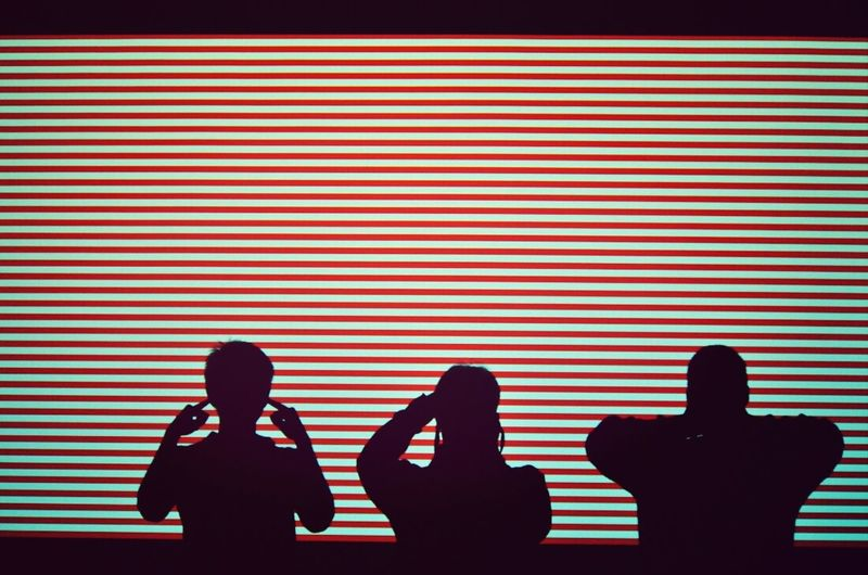 Silhouette people covering eyes ears and mouth
