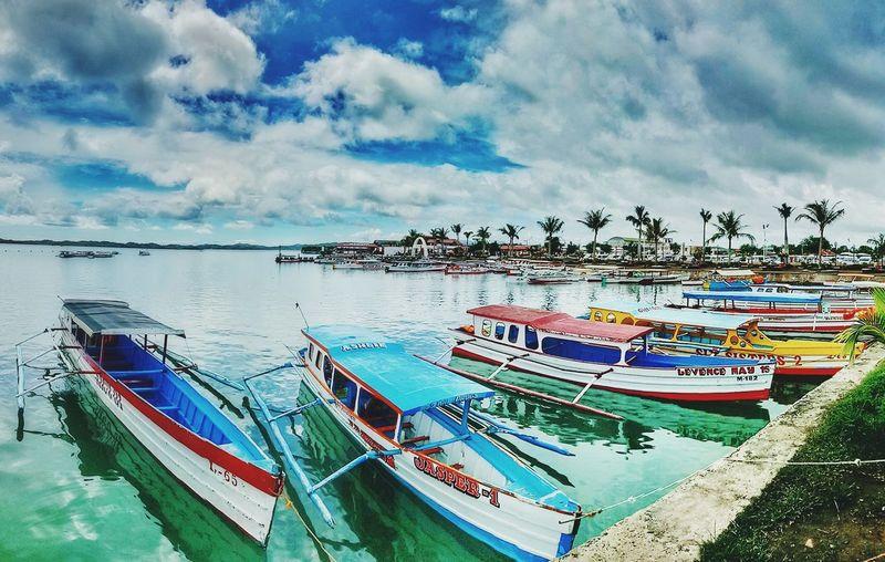Boats and Colors 💕 HundredIslandPhilippines Choosephilippines Nautical Vessel Water Sea Moored Beach Sky Cloud - Sky First Eyeem Photo