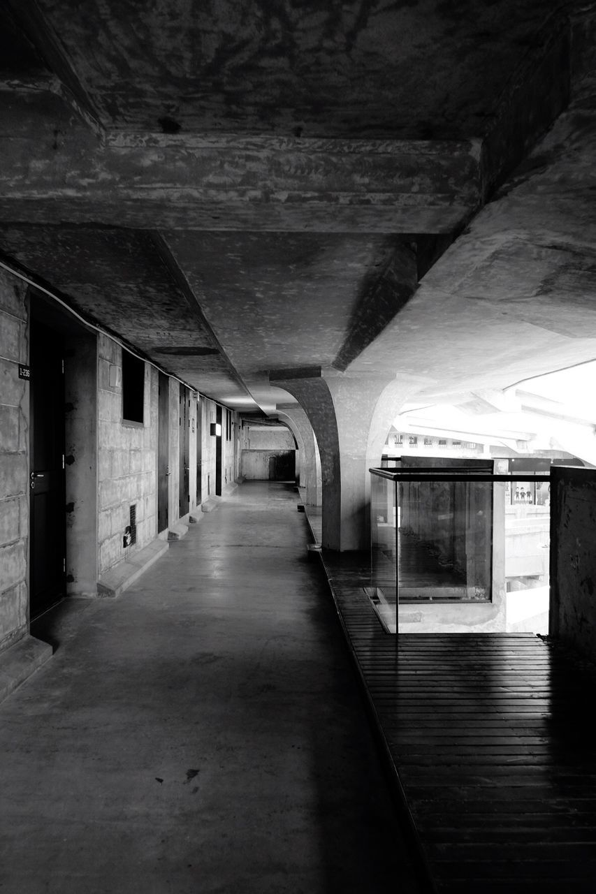 indoors, the way forward, empty, ceiling, corridor, illuminated, built structure, no people, tunnel, architecture, architectural column, day