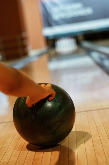 Bowling Bowling Alley Bowling Bowling Balls Bowlingnight Game Leisure Activity Leisure Games EyeEmNewHere Human Hand Hand Human Body Part Indoors  Focus On Foreground Body Part Table Close-up Lifestyles Wellbeing Ball