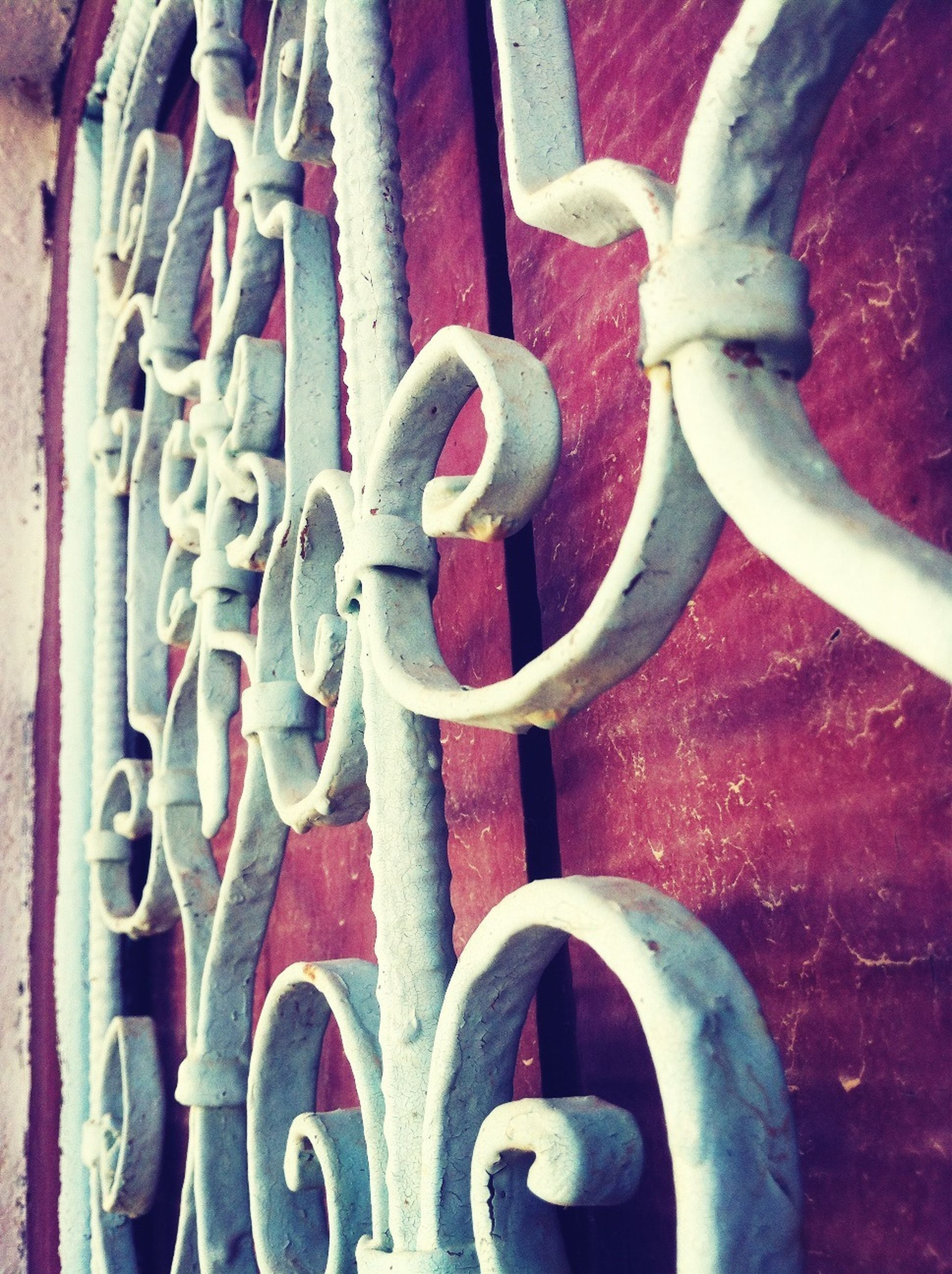 metal, close-up, red, metallic, rusty, safety, no people, pattern, protection, circle, day, full frame, wall - building feature, built structure, part of, outdoors, design, security, architecture, railing