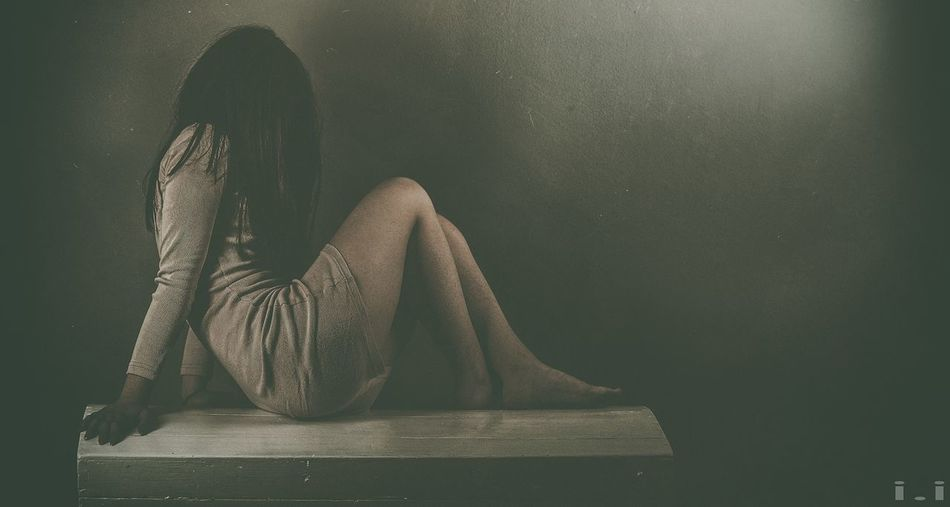 One Person Sitting Sadness Indoors  Depression - Sadness Full Length Long Hair Women Real People Emotion Disappointment Adult Lifestyles Emotional Stress Hair Black Hair Young Adult Young Women Depression Hairstyle Contemplation Beautiful Woman Obscured Face