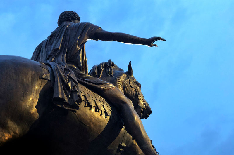 Low angle view of statue against sky