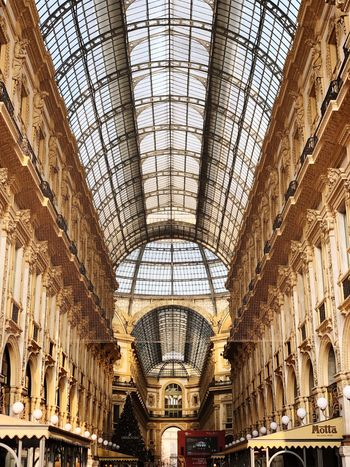 Windows Stores Duomo Columns Travel Destinations Architecture Exterior Interior Design EyeEm Selects Architecture Built Structure Indoors  Ceiling Low Angle View Arch No People Building Day History Architectural Feature Pattern The Past Architecture And Art Travel Destinations Shopping Mall Luxury Design Ornate Travel