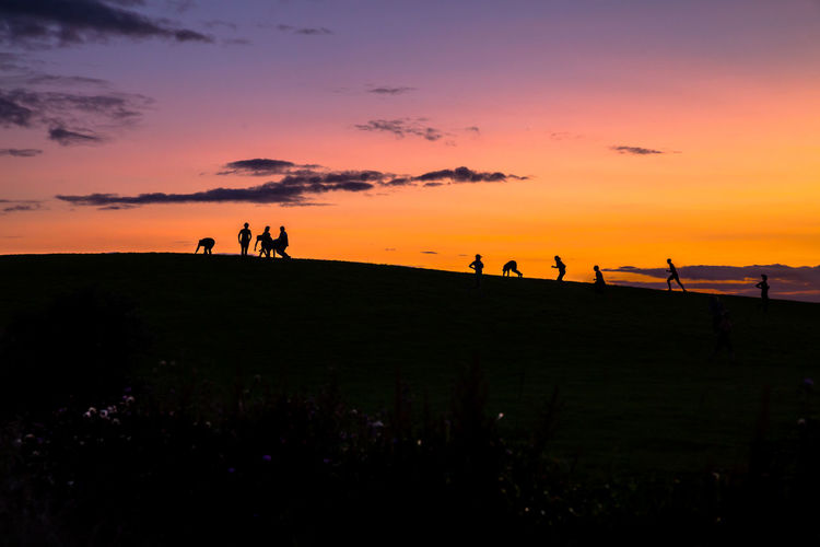 Run Adult Beauty In Nature Large Group Of People Leisure Activity Lifestyles Men Nature Orange Color Outdoors People Real People Scenics Sea Silhouette Sky Sunset Togetherness Traning Tranquil Scene Tranquility