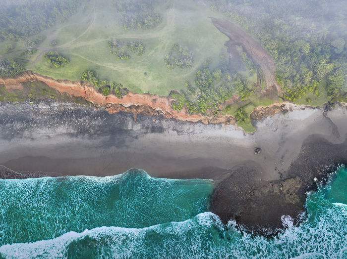 Beach view from the air with calm waves during the day in north bengkulu, indonesia