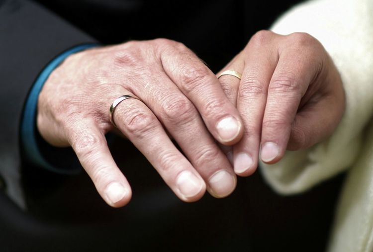 Cropped Hands Of Senior Couple
