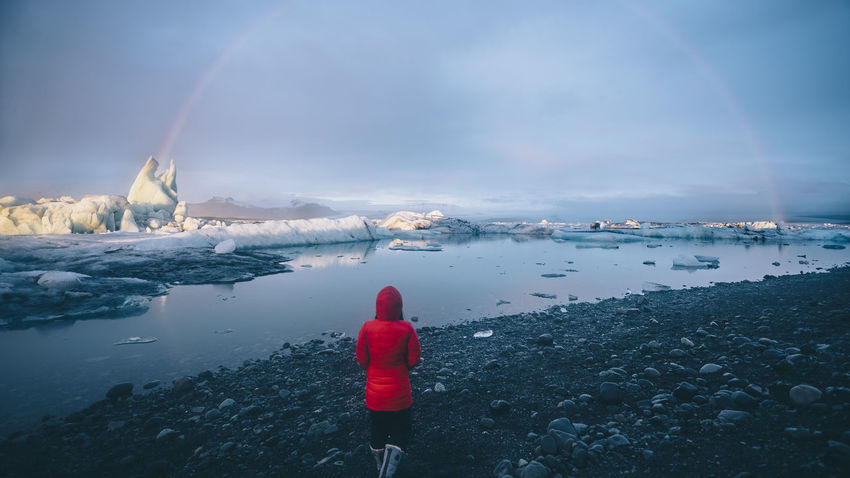 Back View Beauty In Nature Cold Temperature Glacier Glacier Lagoon Iceberg Iceland Jökulsárlón Glaciar Lagoon Nature One Person Outdoors Rainbow Rainbows Red Scenics Tranquil Scene Tranquility Walking Water Winter The Great Outdoors - 2017 EyeEm Awards Let's Go. Together. Breathing Space Your Ticket To Europe Shades Of Winter An Eye For Travel Love Yourself