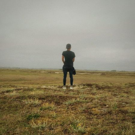 Clément Field Beauty In Nature People Standing Sky Day Outdoors Grass One Person Real People Nature Full Length Landscape