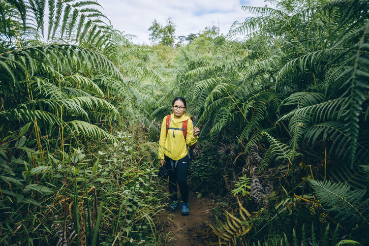 Adult Agriculture Beauty In Nature Casual Clothing Day Field Front View Full Length Green Color Growth Happiness Looking At Camera Nature One Person Outdoors Plant Portrait Real People Rice Paddy Sky Smiling Standing Tree Young Adult Young Women Press For Progress