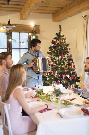 People on christmas tree