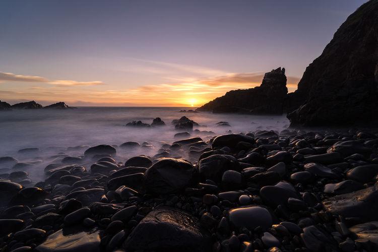prehistoric coast Astronomy Sea Water Wave Sunset Beach Dawn Arrival Sand Silhouette Tide Seascape Rocky Coastline Coastline Ocean