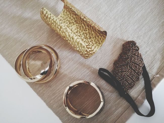Jewellery Jewelleryaddict Bracelets✨ Shades Of Gold Ready To Party!!! Ready To Go Out  Objects On The Table Objects Telling Stories Bijouterie EyeEm Selects Table High Angle View Close-up