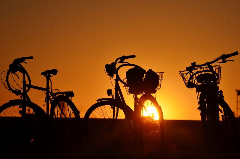 Berlin, the city of bikes 🇩🇪🚲 Bicycle Sunset Transportation Mode Of Transport Orange Color Silhouette Outdoors Nature No People Sky Berlin Sun Traveling Travel Travel Destinations
