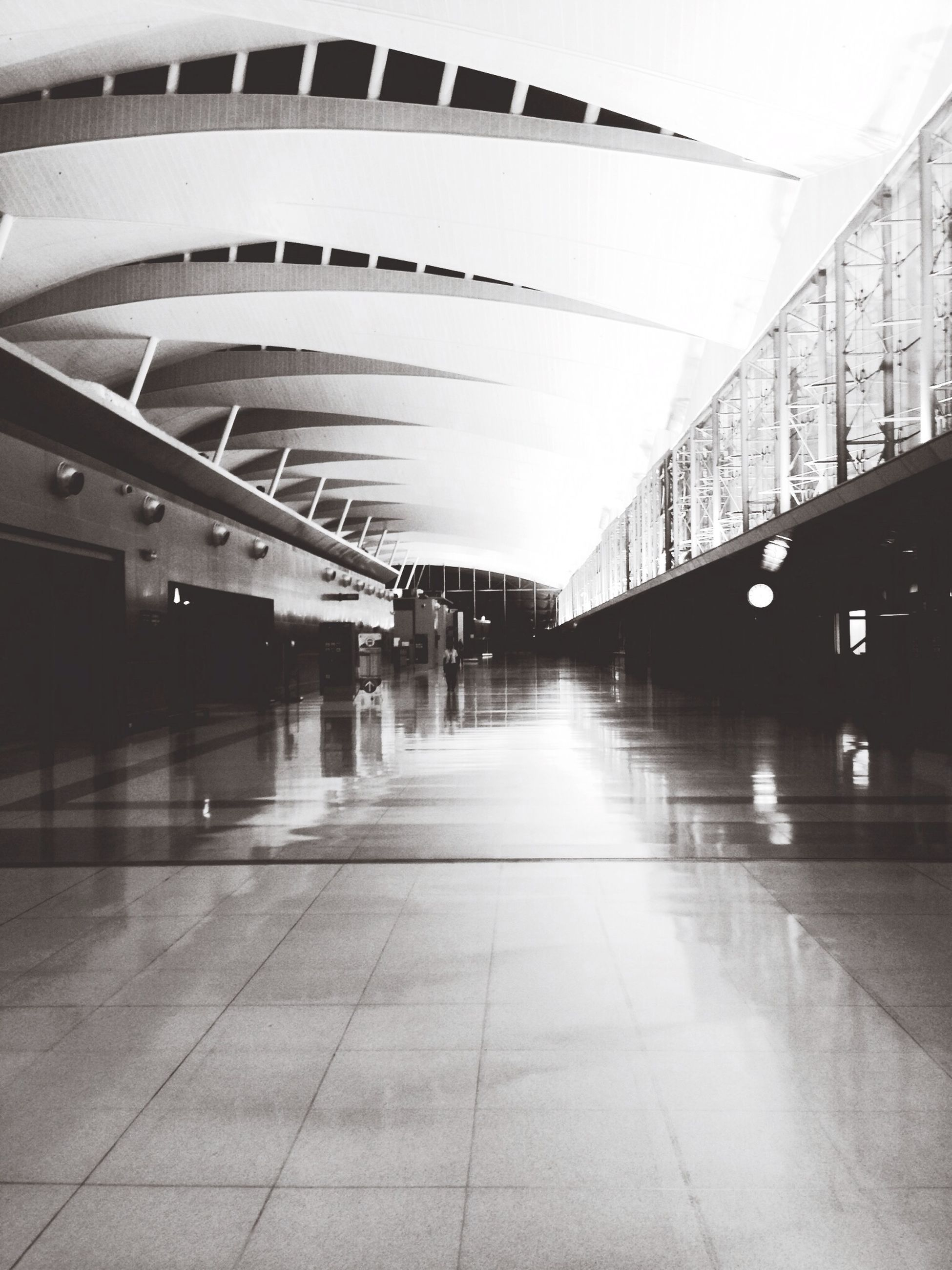 architecture, built structure, indoors, the way forward, ceiling, illuminated, diminishing perspective, empty, modern, lighting equipment, building, flooring, vanishing point, tiled floor, reflection, absence, corridor, no people, building exterior, incidental people