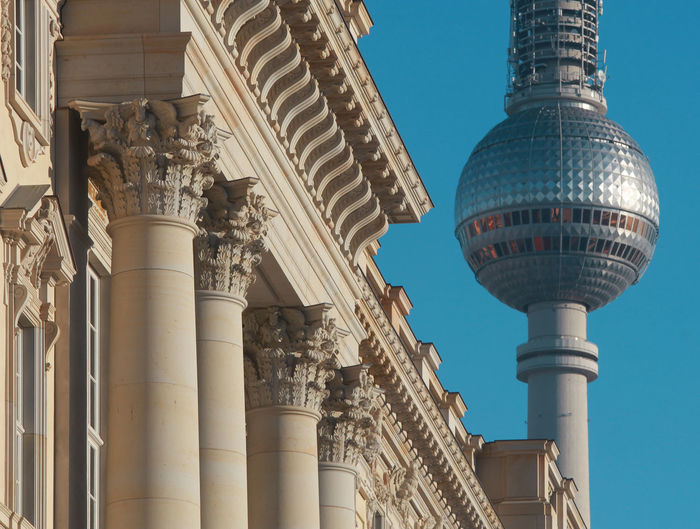 Facade details of berlin palace with television tower in background