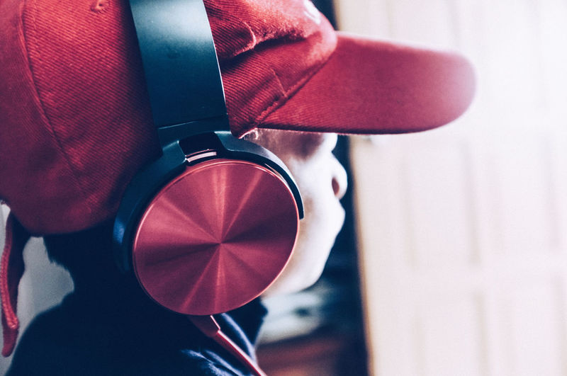 Boy Cap Close-up Day Earphone Headphone Lifestyles Listening To Music Mp3 Music Outdoors Red TakeoverMusic