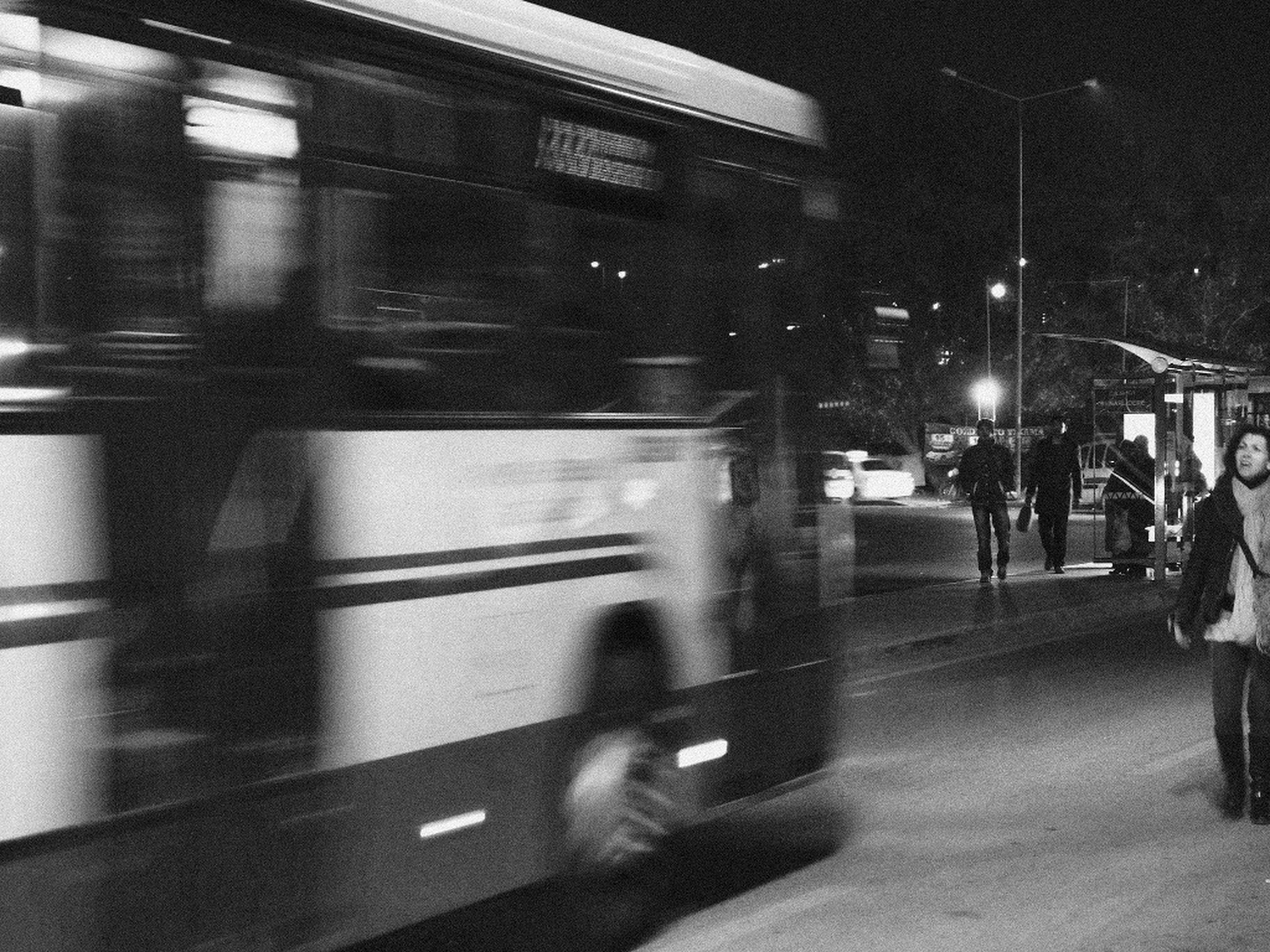 transportation, mode of transport, land vehicle, car, on the move, travel, public transportation, illuminated, street, blurred motion, road, night, men, city life, motion, railroad station platform, train - vehicle, city