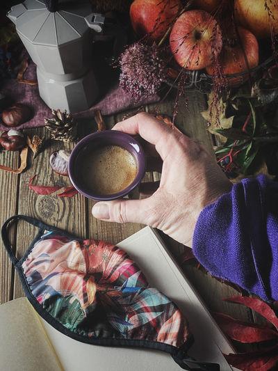 High angle view of hand holding coffee
