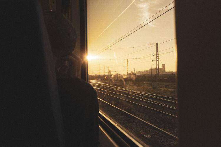 Railroad tracks seen through train window