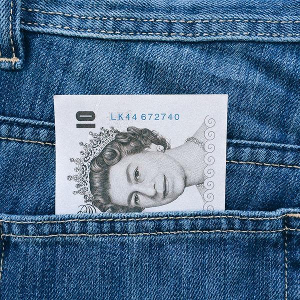 UK ten pound note protruding from pocket 10 Pound Note 10 Pounds Blue Cash Close-up Denim Face Features Legal Tender Money Note Paper Pocket  Pocket Money Pound Protruding Queen Queen Elizabeth  Queens Head Single Object Symbol Ten Pound Note Uk