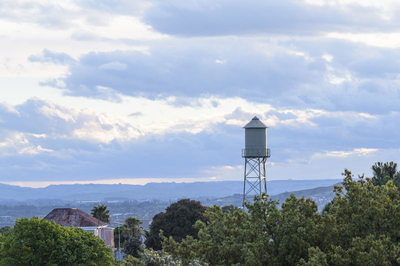 Scenic view of water tower against sky