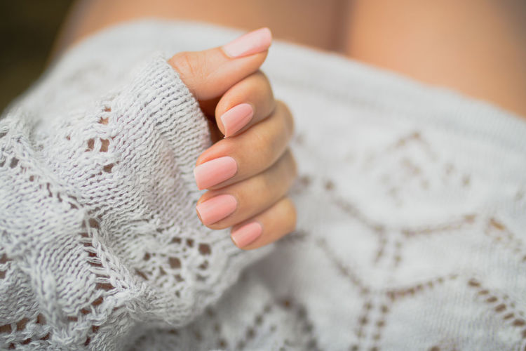 Close-up of hand with tattoo during winter