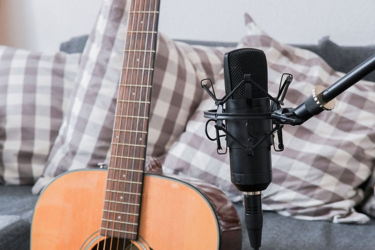 Acoustic guitar and recording microphone in foreground Music Musical Instrument Guitar Musical Equipment Acoustic Guitar Condenser Microphone Studio Recording Studio Homerecording Microphone Input Device Microphone Stand