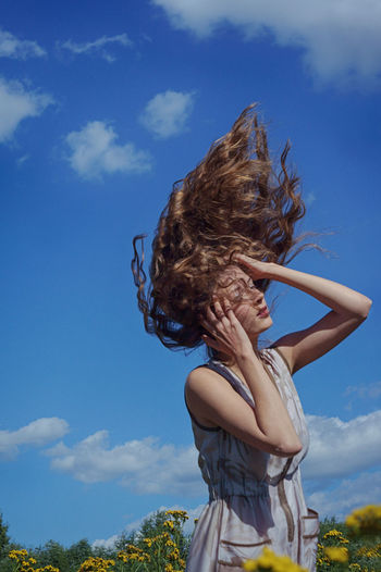 Day Lifestyles Blue Wind Sky Hair Women One Person Cloud - Sky Hairstyle Nature Long Hair Girls Standing Real People