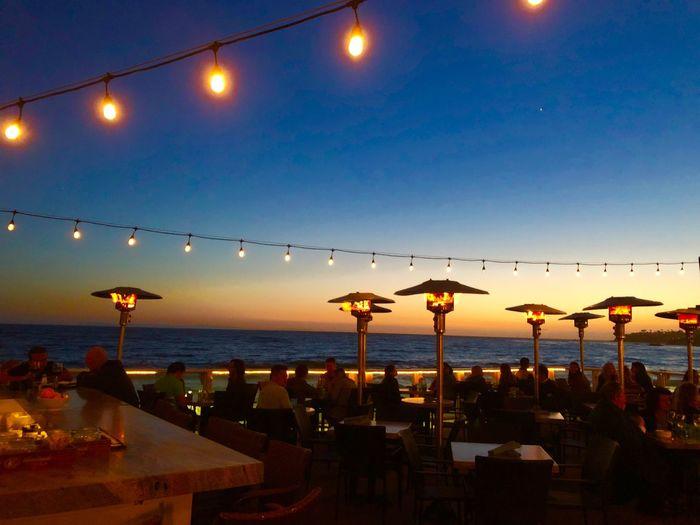 Romantic Dinner Dating Spot Dating Restaurant By The Sea Restaurant Water Sky Illuminated Sea Lighting Equipment Sunset Nature Horizon Over Water Dusk Beach Night