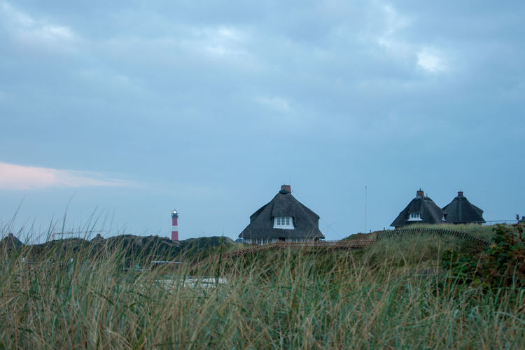 Lighthouse Sylt, Germany Architecture Building Building Exterior Built Structure Cloud - Sky Day Environment Field Grass House Land Landscape Marram Grass Nature No People Outdoors Plant Residential District Scenics - Nature Sky Tranquility
