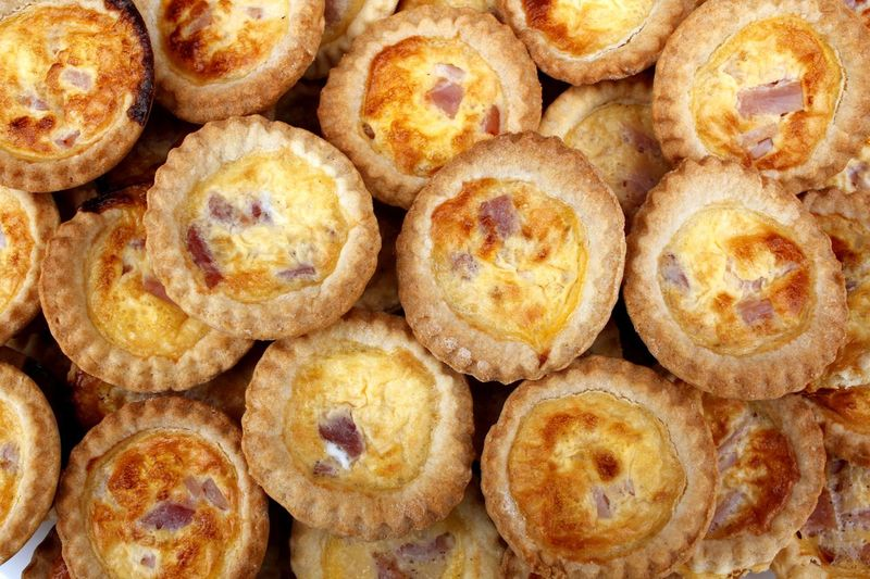 Small quiches cooked fresh ready for the party Party Food Backgrounds Bacon And Egg Pie Bite Size Close-up Day Food Food And Drink Freshness Full Frame Healthy Eating Indoors  Large Group Of Objects Mini Quiche No People Quiche Ready-to-eat Savoury Food Sweet Food Tasty