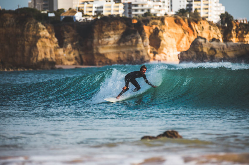 My favourite from the whole trip... Algarve City Cityscape Portugal Rock Surf Adult Adventure Extreme Sports Lifestyles Men Motion Nature One Person Outdoors Real People Sea Skill  Speed Sport Surfing Vacations Water Waterfront Wave Shades Of Winter An Eye For Travel