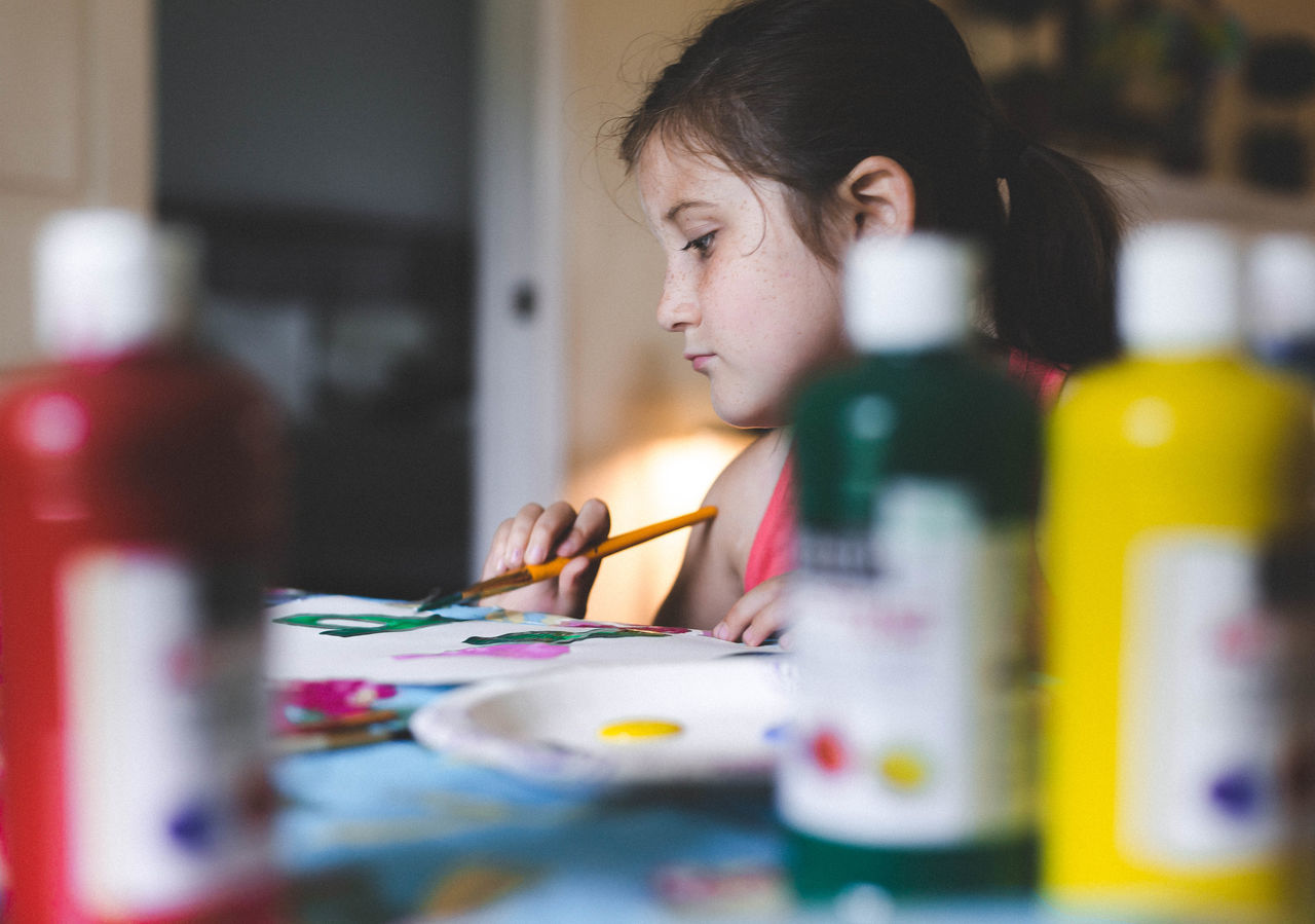 Girl painting at home